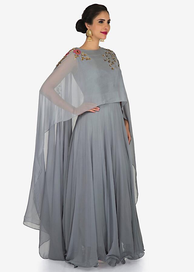 Grey gown in georgette is beautified with sequin and moti embroidery work only on Kalki