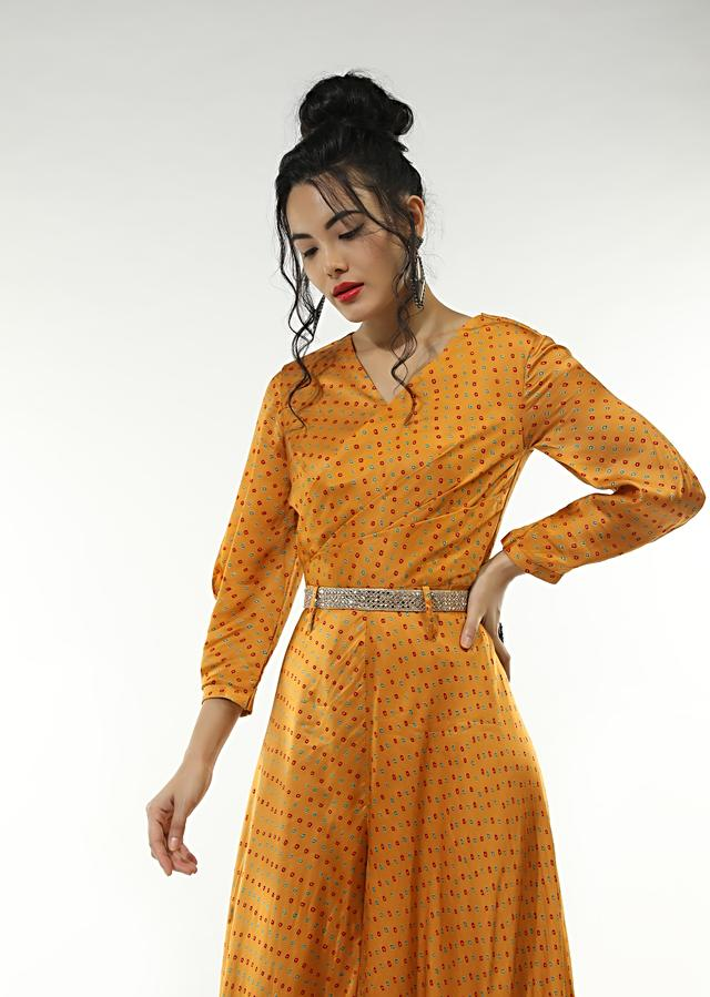 Honey Yellow Jumpsuit In Satin Blend With Bandhani Print All Over And An Overlapping Pleated Bodice With A Mirror Belt Online - Kalki Fashion