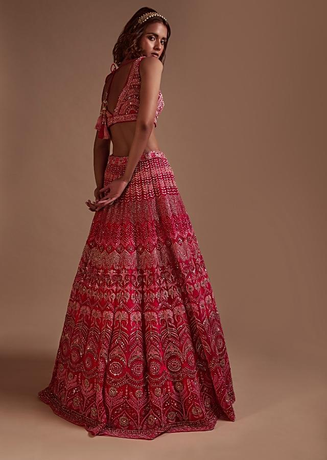 Hot Pink Lehenga Choli In Net With Mirror Work In Floral And Mughal Motifs Along With A Tassel Belt Online - Kalki Fashion
