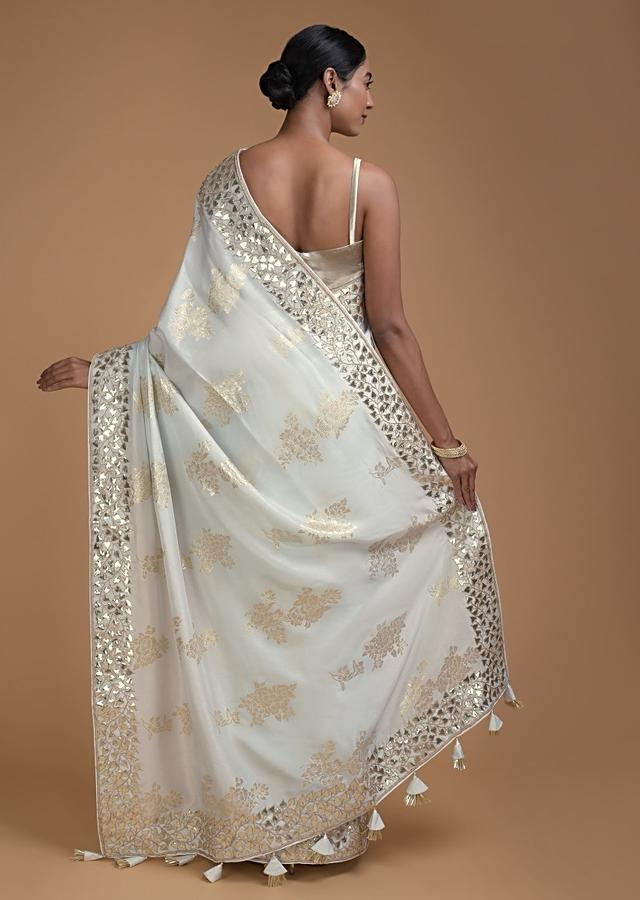 Icy Blue Saree In Silk With Weaved Floral Motifs In Repeat Pattern Online - Kalki Fashion