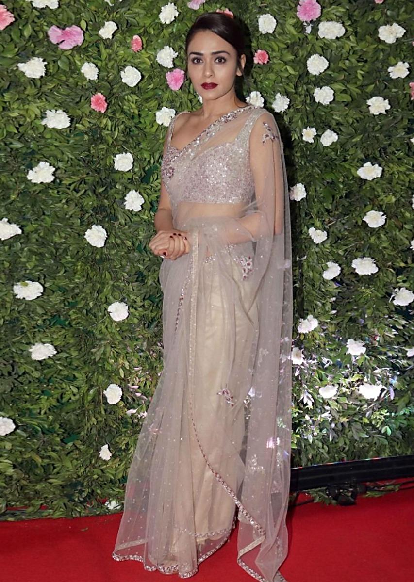 8db506e6f9 Amruta Khanvilkar in Kalki grey sheer net saree with floral embroidered  buttiMore Detail