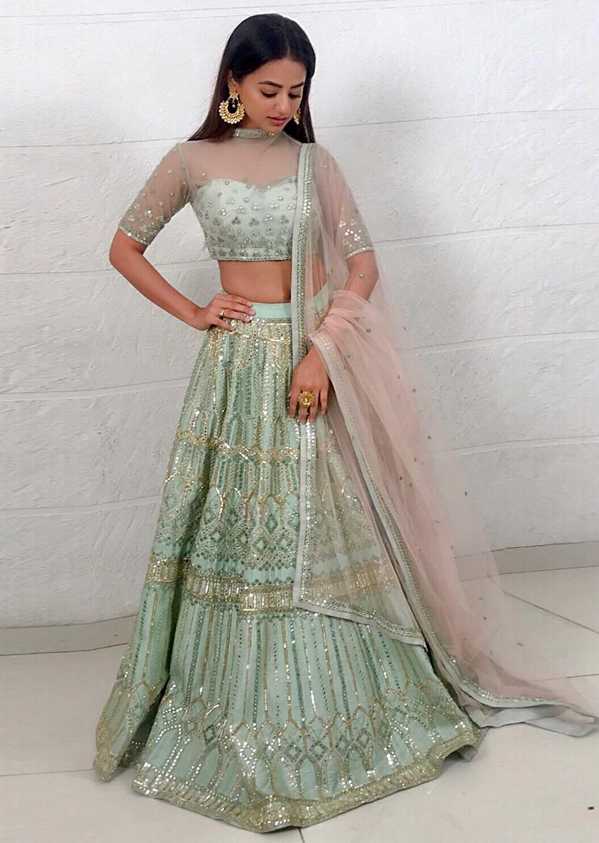 205fd5f94ebed1 Helly Shah pistachio green embellished net lehenga paired with a matching net  blouse and light cream ...