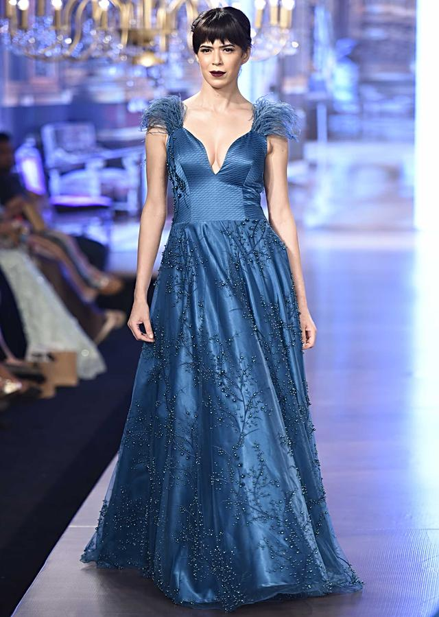 Indo-western gown in teal with quilted bodice and intricate pearl work only on Kalki