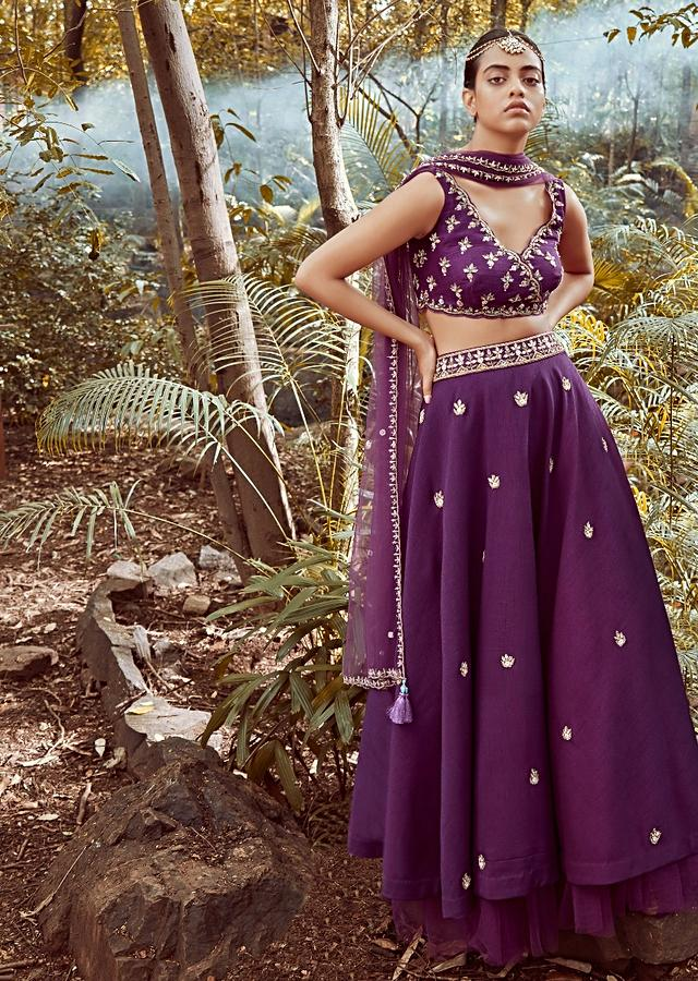 Irish Purple Lehenga Choli In Raw Silk With Cut Dana And Beads Embroidered Floral Buttis And Overlapping V Neckline Online - Kalki Fashion