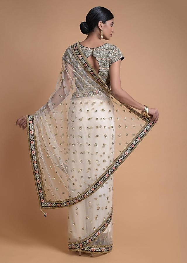 Ivory Beige Saree In Net With Floral Buttis And Resham Embroidered Floral Border Online - Kalki Fashion