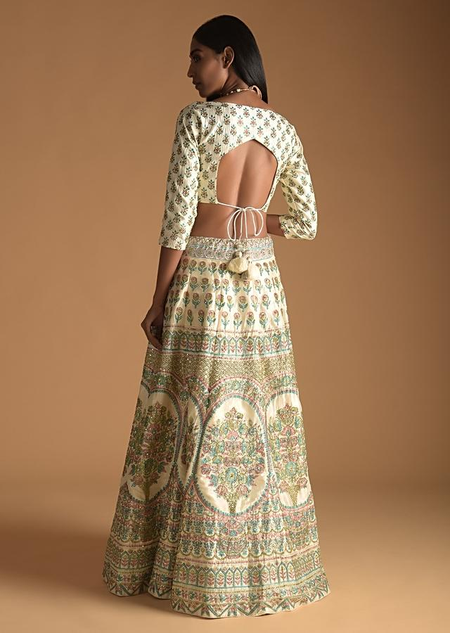 Ivory Cream Lehenga Choli In Silk With Foil Printed Floral And Temple Motifs Online - Kalki Fashion