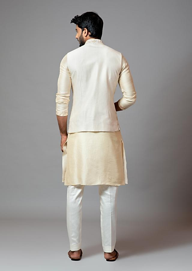 Ivory Nehru Jacket With Delicate Jaal Embroidery Paired With A Tonal Kurta Set By Smriti Apparels