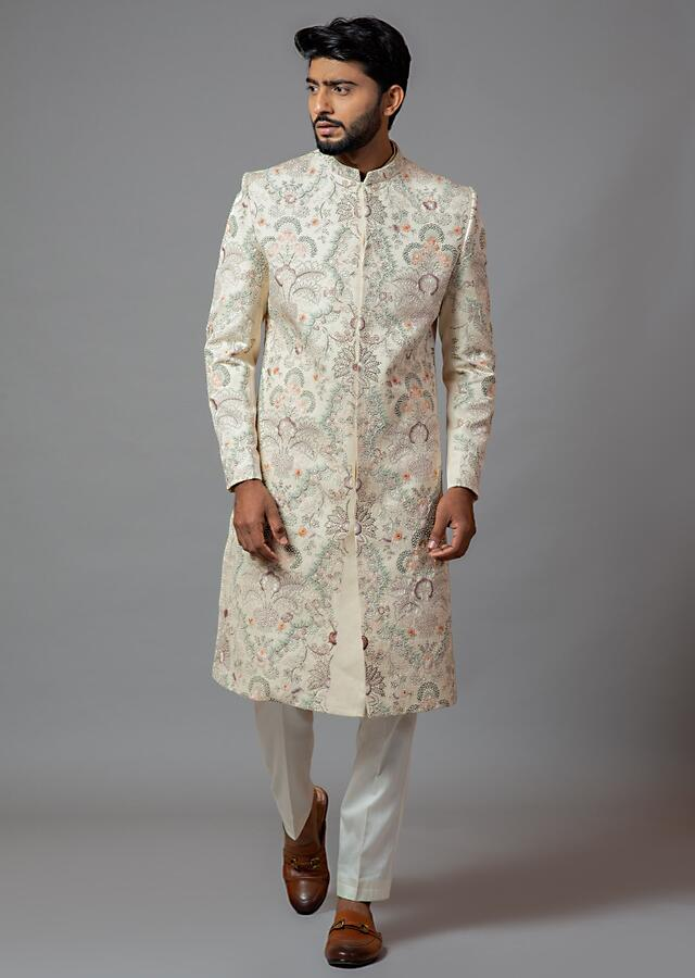 Ivory Sherwani In Linen Satin With Heavy Multi Colored Jaal Embroidery And Cream Pajama By Smriti Apparels
