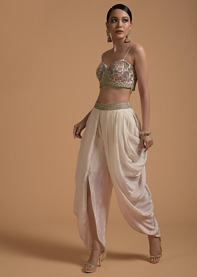 Ivory Tulip Dhoti And Crop Top Set With Embossed Embroidery One Shoulder Cape Online - Kalki Fashion