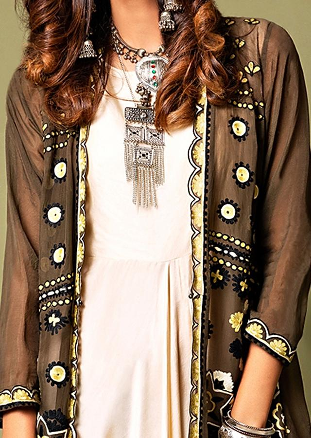 Ivory White Cowl Jumpsuit Paired With A Contrasting Olive Jacket Featuring Mandala Aari Embroidery Online - Kalki Fashion