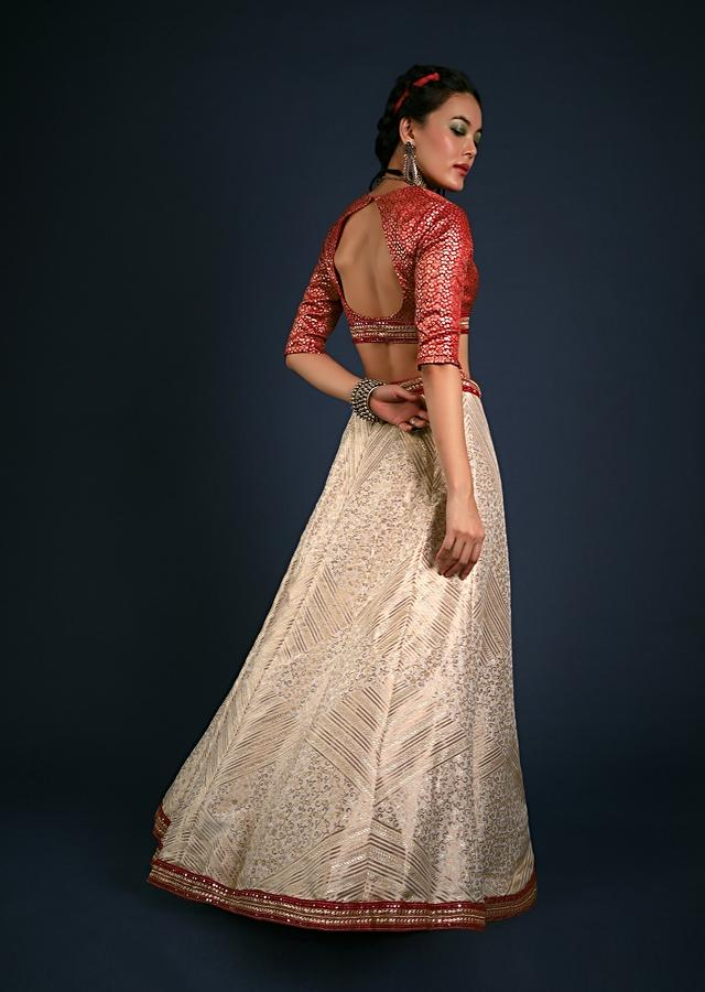 Ivory White Lehenga In Brocade Silk With Woven Kali Design And Contrasting Red Brocade Unstitched Blouse And Dupatta Online - Kalki Fashion