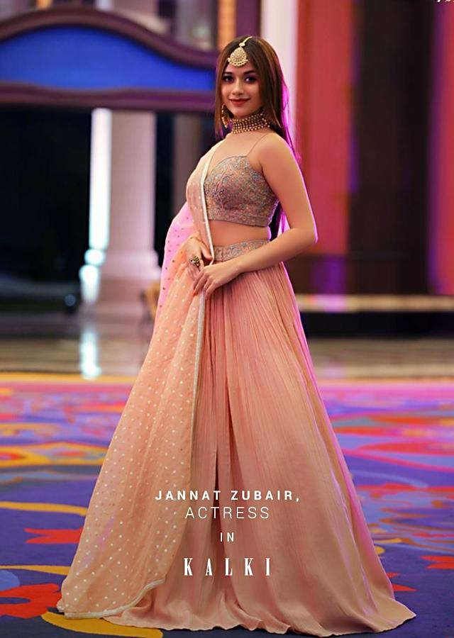 Jannat Zubair In Kalki Powder Peach Lehenga Choli With Hand Embroidery Using Turquoise And Pink Sequins Work