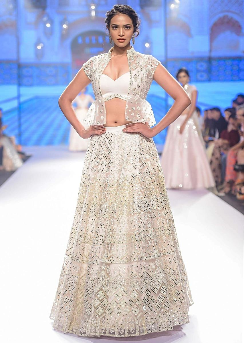 e84d31a9d4 Lace pink net lehenga with bustier and peplum jacket in abla work only on  KalkiMore Detail
