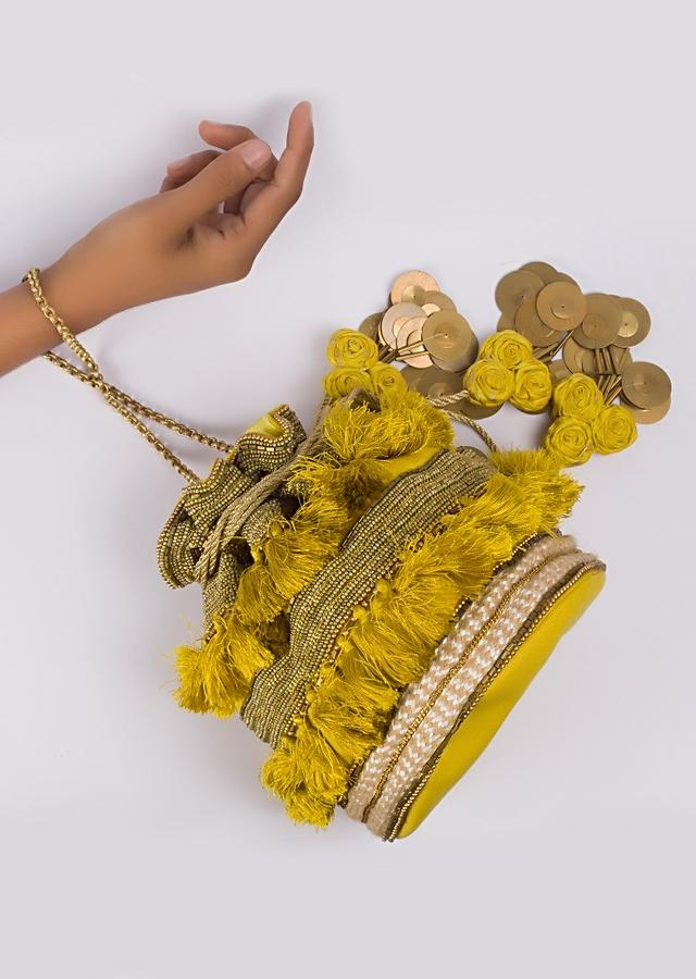 Yellow Tassel Potli with layers of bead work, sequins work, chain and jute work By Vareli Bafna