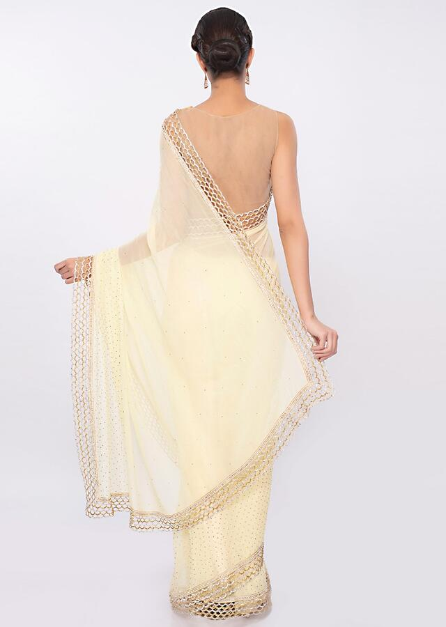Lemon yellow georgette saree with cut out border only on Kalki