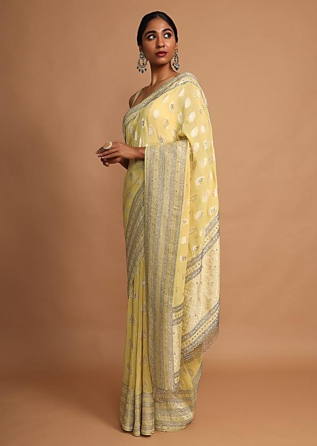 Lemon Yellow Saree In Georgette With Weaved Floral Buttis Online - Kalki Fashion