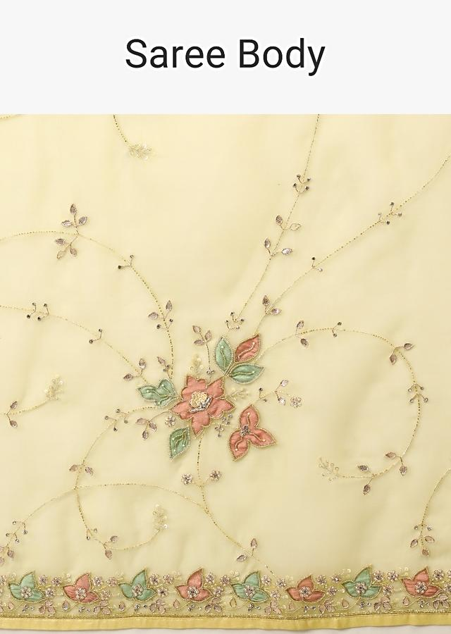 Lemon Yellow Saree In Organza With Multi Colored Applique Flowers On The Border And Cut Dana Accents Online - Kalki Fashion