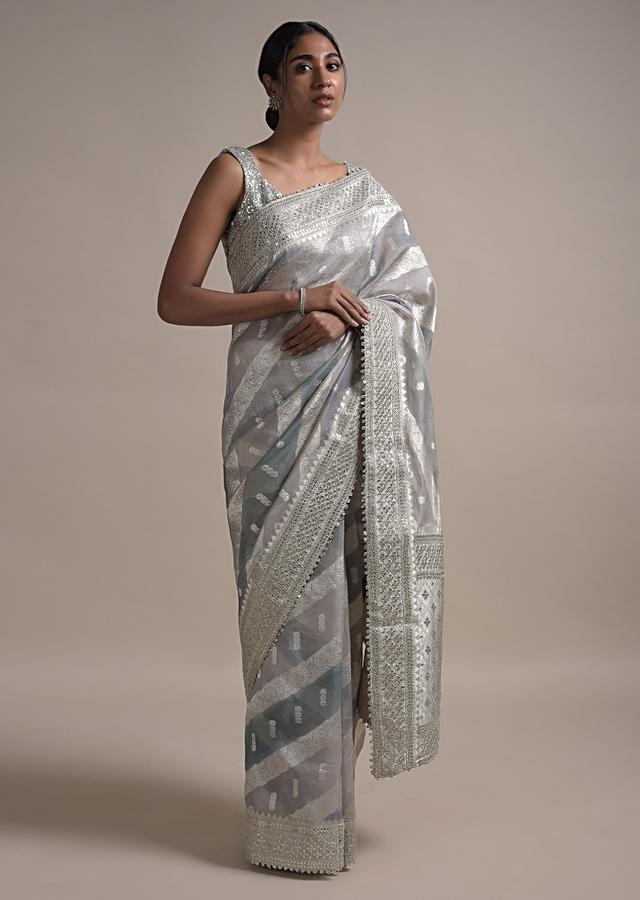 Light And Dark Grey Shaded Saree In Organza With Weaved Floral Pattern In Diagonal Stripes Online - Kalki Fashion