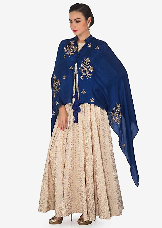 Cream Anarkali Suit Matched With Royal Blue Embroidered Fancy Cape Online - Kalki Fashion