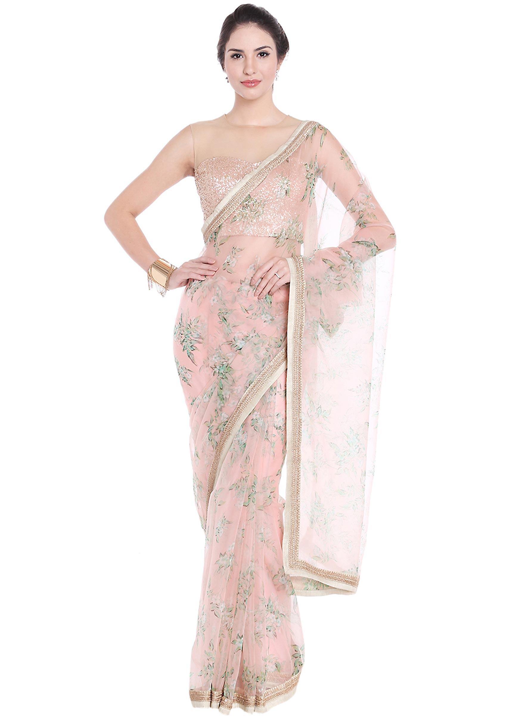 765b18092417b6 Light peach saree embellished in floral motif with contrast border only on  Kalki