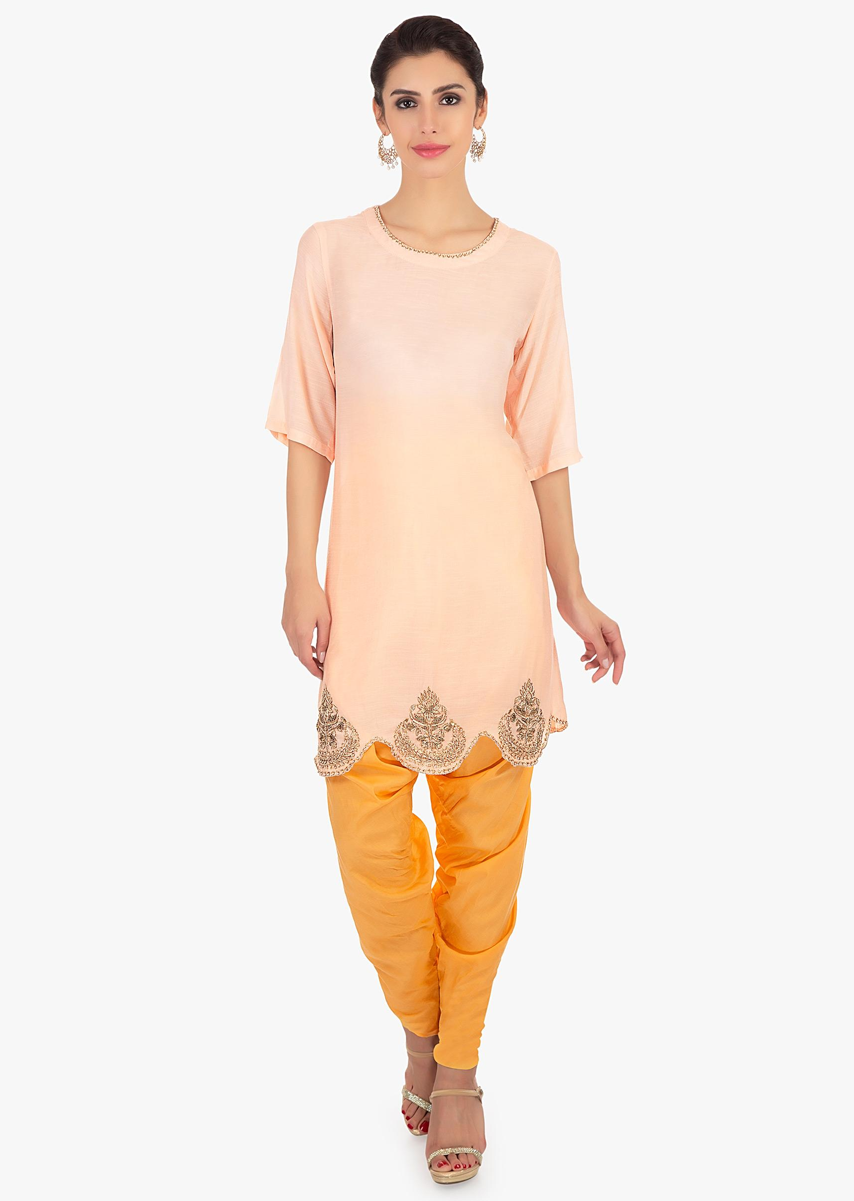 b6e289f9e5 Light peach top paired with a yellow dhoti pant only on KalkiMore Detail