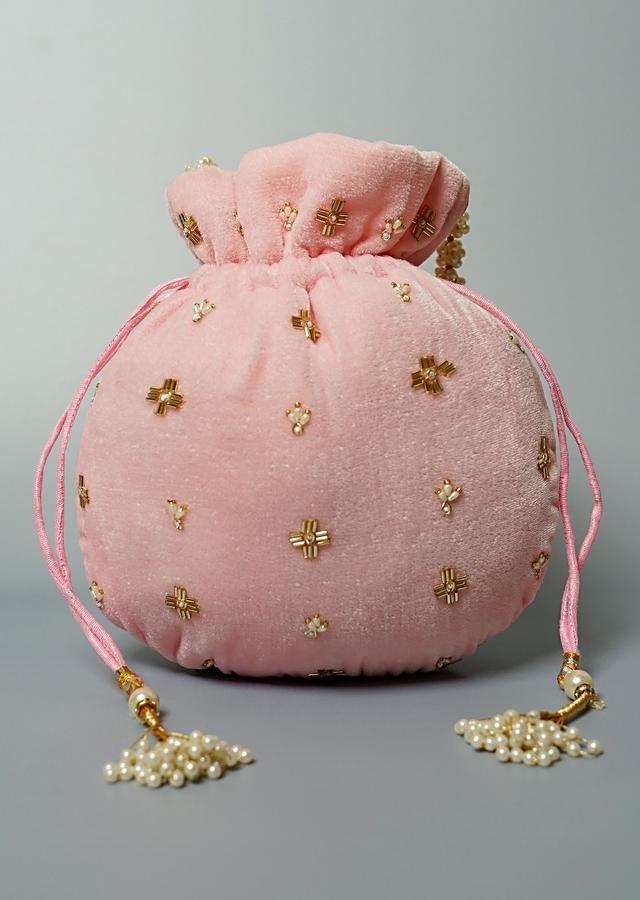 Light Pink Potli Bag In Velvet With Cut Dana And Beads Embroidered Jaal Design By Shubham