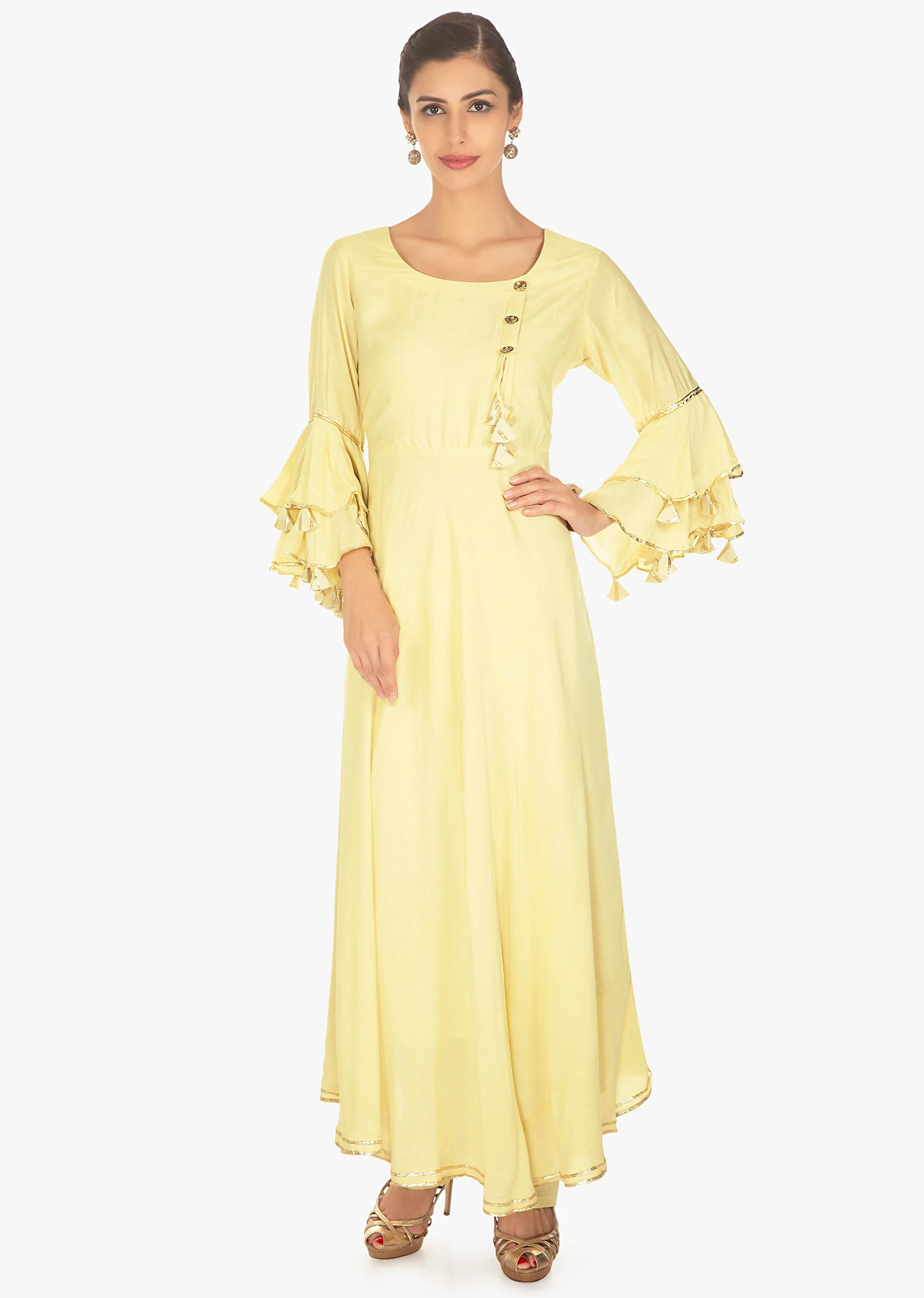 0162667def454 lime yellow cotton suit set with fancy buttons and angel sleeves only on  KalkiMore Detail