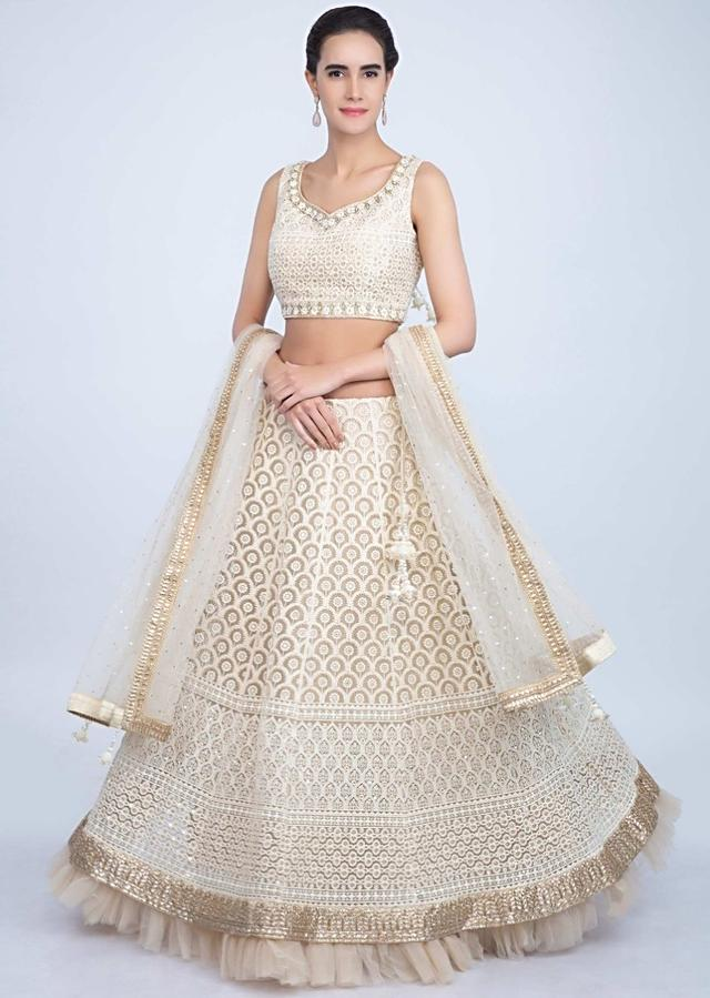Cream Lehenga Set With Lucknowi Embroidery And Net Ruching Online - Kalki Fashion