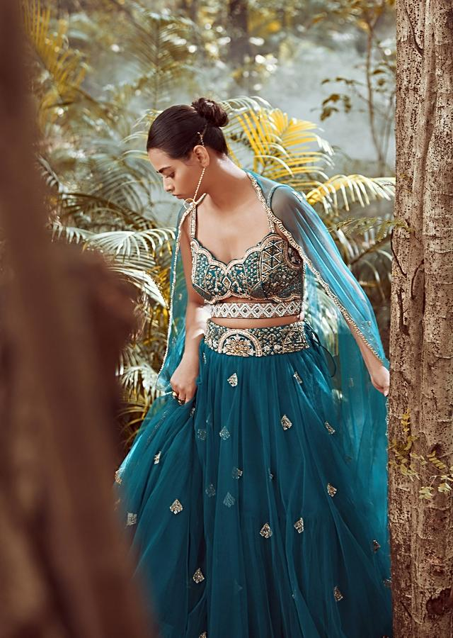 Nighttime Blue Lehenga In Net With Cut Dana And Sequins Embroidered Choli Designed With A Front Cut Out Online - Kalki Fashion