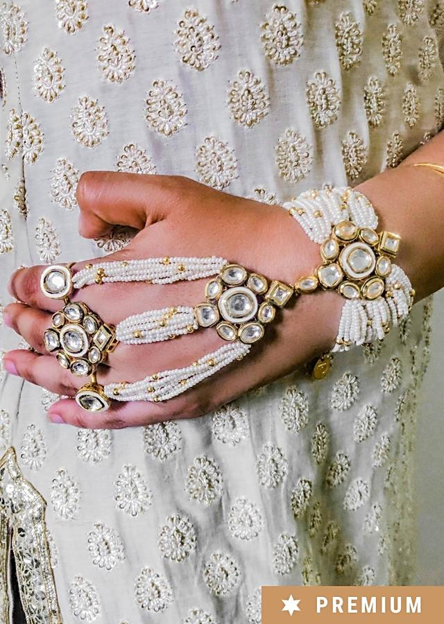 Gold Plated Hand Harness With Strings Of Pearls, Gold Beads And Kundan Work By Prerto