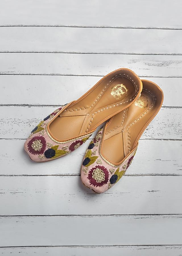 Powder Pink Juttis In Raw Silk With Bright Thread And Zari Embroidered Flowers By Vareli Bafna