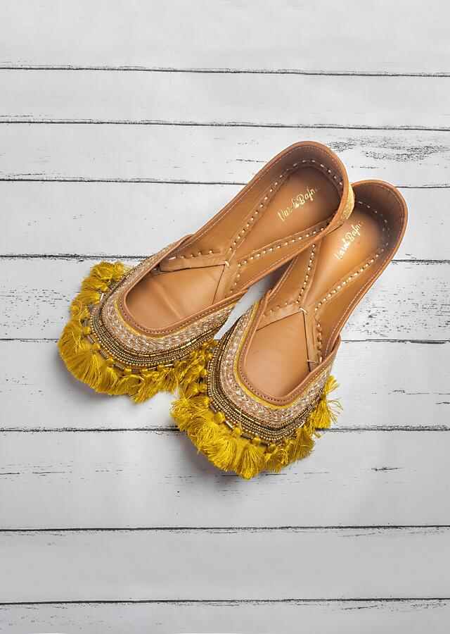 Mustard Juttis In Silk With Beads And Sequins Work Along With Tassels By Vareli Bafna