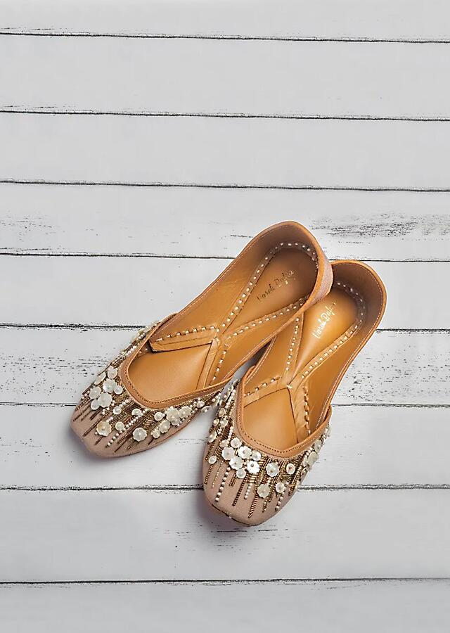 Dusky brown Juttis In Raw Silk With Shell Flowers, Beads And Silver And Antique Gold Cut Dana Work By Vareli Bafna