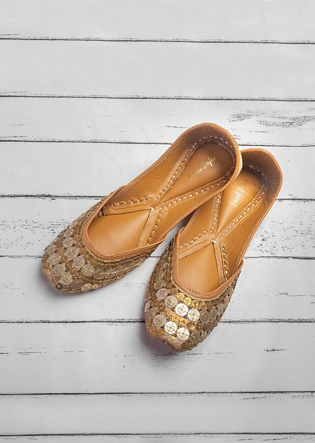 Gold Juttis In Raw Silk With Coin And Zari Work In Gold And Silver By Vareli Bafna