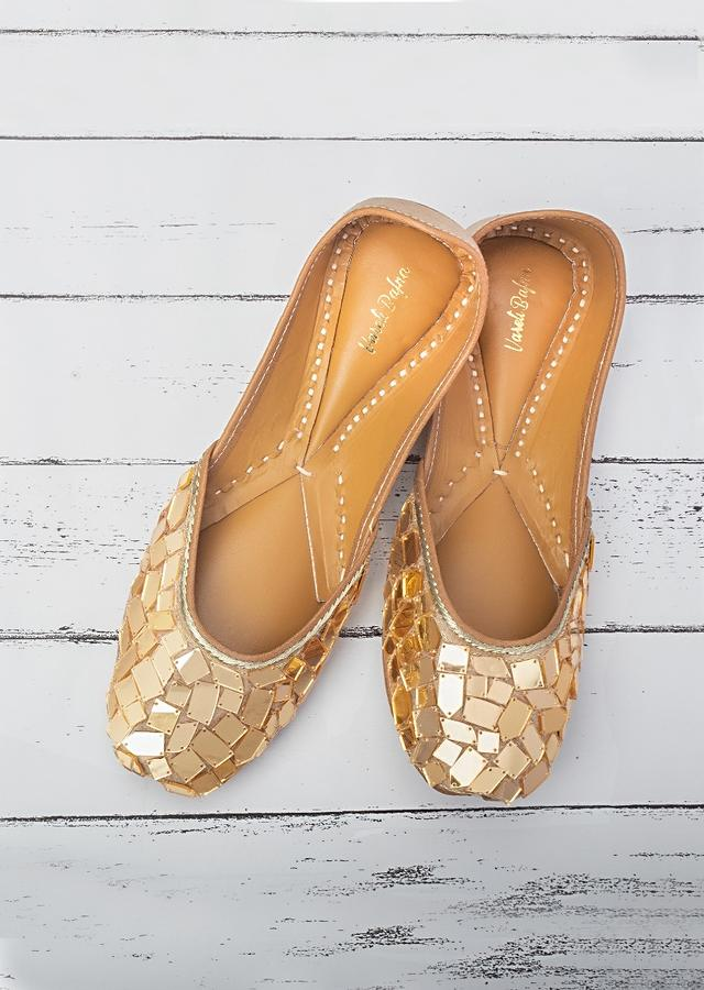 Gold Juttis In Raw Silk With Gold Acrylic Mirror Work In Mosaic Pattern By Vareli Bafna