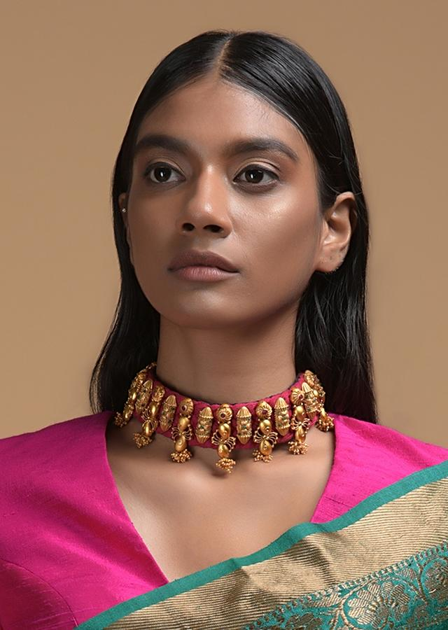 Magenta Braided Choker And Earrings Set With Gold Plated Ethnic Charms Studded With Green And Magenta Stones Online - Kalki Fashion