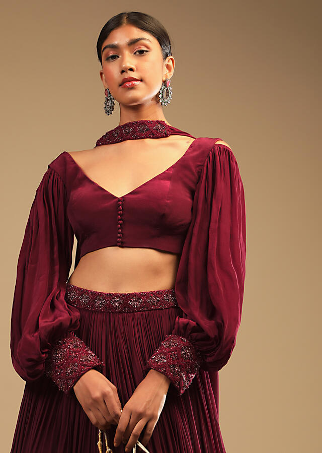 Maroon Lehenga In Crepe With Embroidery Detailing On The Waist And Bishop Sleeved Crop Top Online - Kalki Fashion