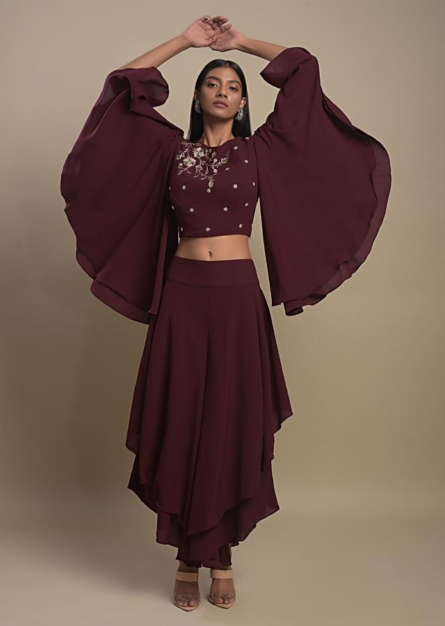 Maroon Palazzo Suit In Crepe With Symmetric High Low Hemline And Bell Sleeve Crop Top Online - Kalki Fashion