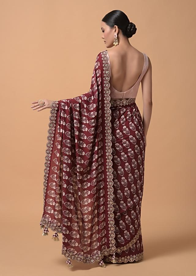 Maroon Saree With Floral Printed Buttis And Gotta Embroidered Border Online - Kalki Fashion