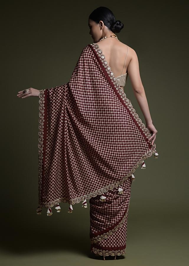 Maroon Saree In Soft Silk With Printed Floral Buttis, Scalloped Gotta Patti Border And Unstitched Blouse Online - Kalki Fashion