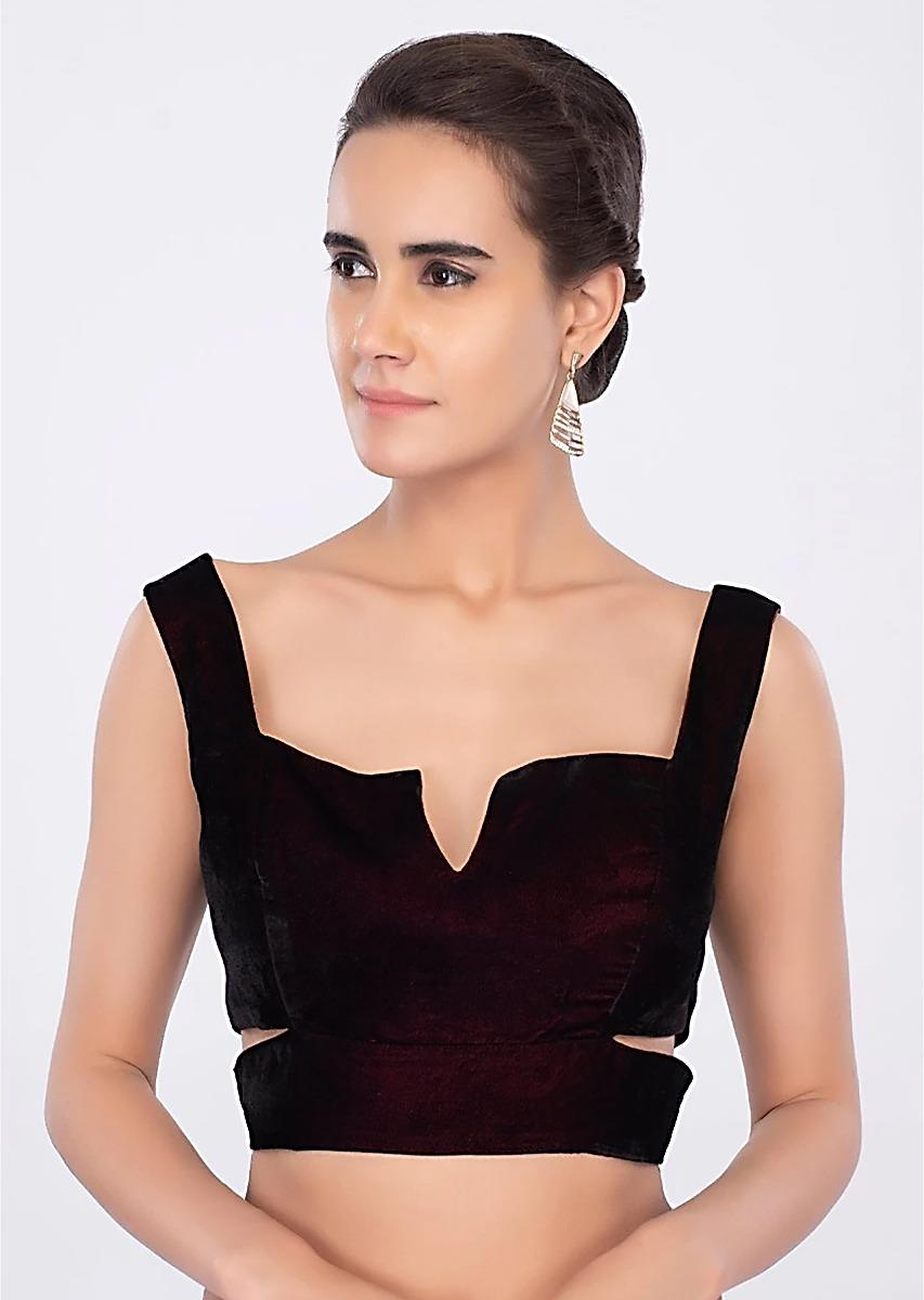 Maroon Sleeveless Blouse With Side Cut Outs And Fancy Cut Symmetric Neckline Online - Kalki Fashion