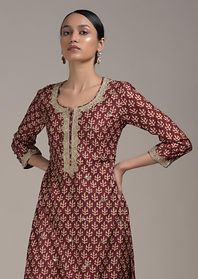 Maroon Straight Cut Suit In Cotton With Batik Printed Buttis And Zari Highlights Online - Kalki Fashion