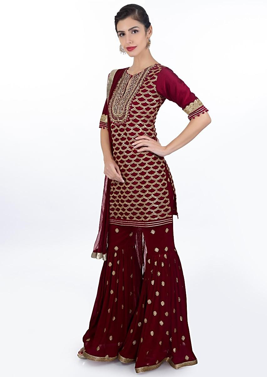 049c5a61bd Maroon Suit In Fish Tail Motif Paired With A Matching Georgette. Green  Embroidered Net Sharara ...