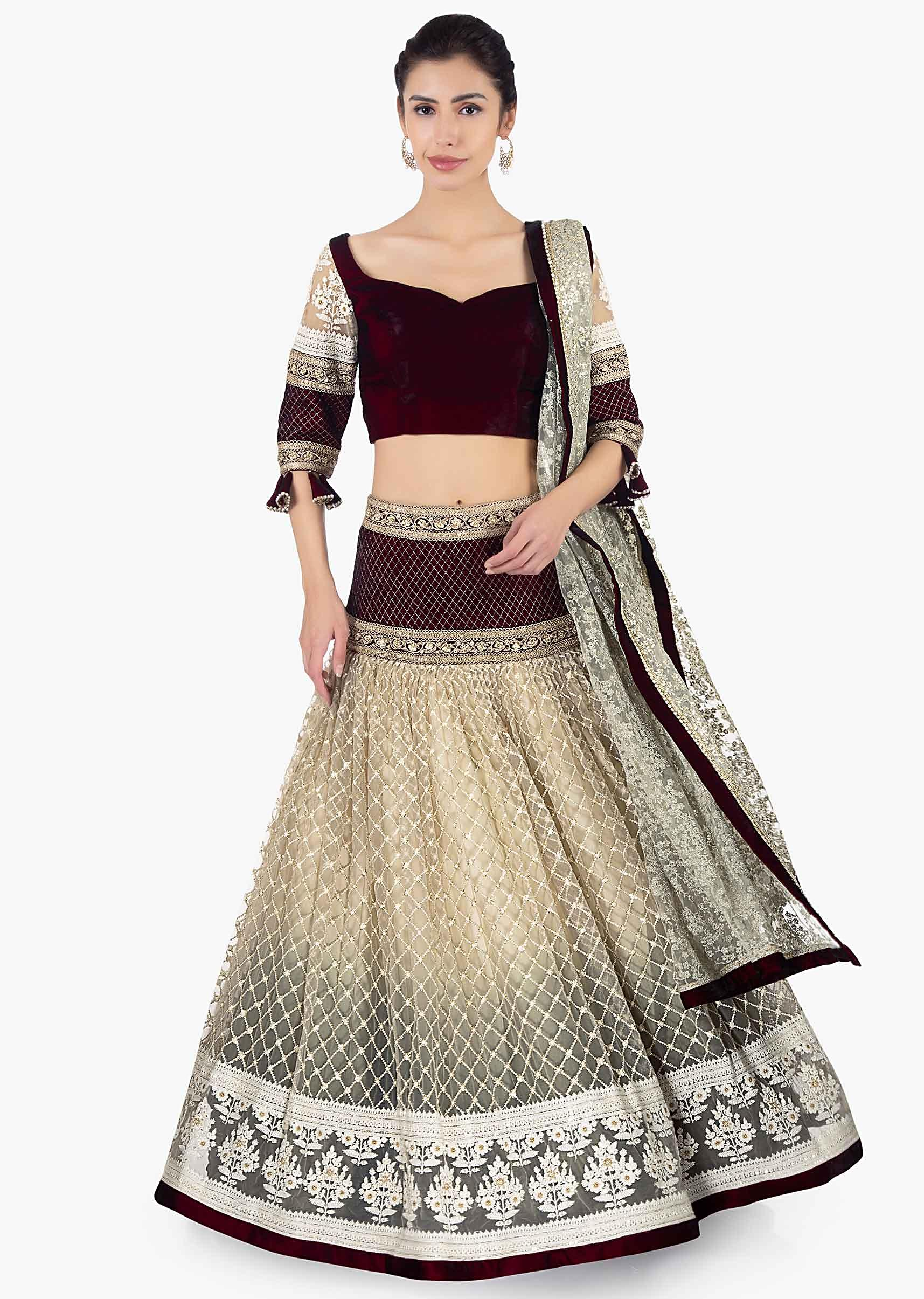 3f87656d457f0 Maroon velvet blouse paired with lehenga in sequins and jaal work and a  matching net dupatta only on KalkiMore Detail