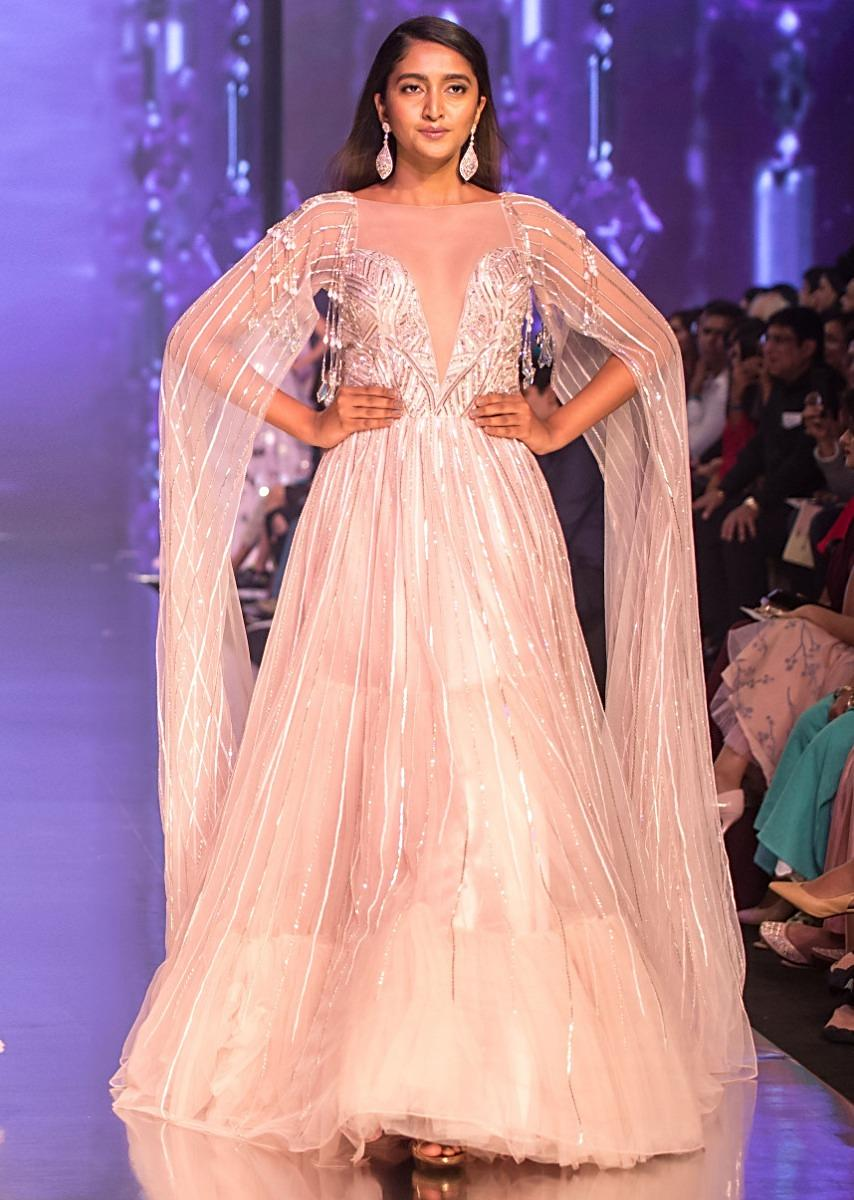 4fa9b2056fe Mauve pink sheer net gown with long extended net flared sleeves only on  KalkiMore Detail