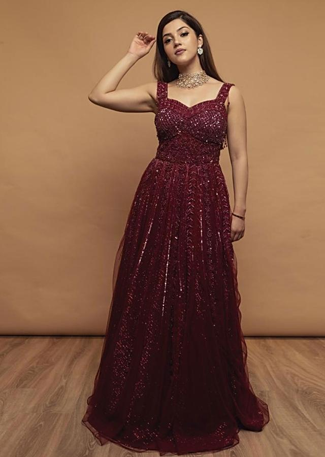 Mehreen In Kalki Burgundy Gown In Embellished Net With Fancy Cut Out Back