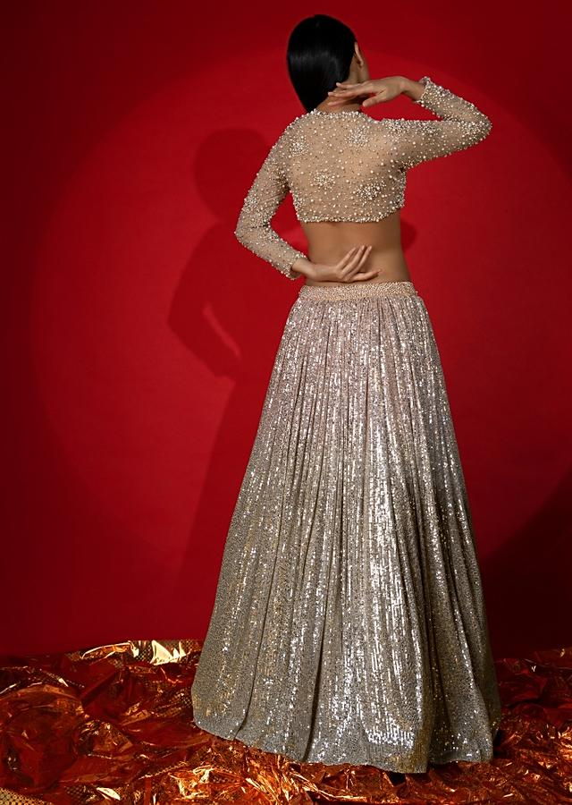Melon Peach Ombre Lehenga In Sequins Fabric With Moti Embroidered Crop Top With Illusion Neckline And Full Sleeves Online - Kalki Fashion