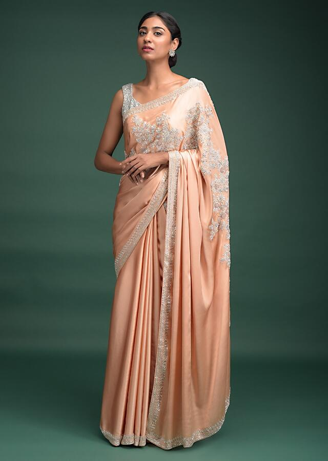 Melon Peach Saree In Satin With Embroidered Floral Pattern On The Border Online - Kalki Fashion