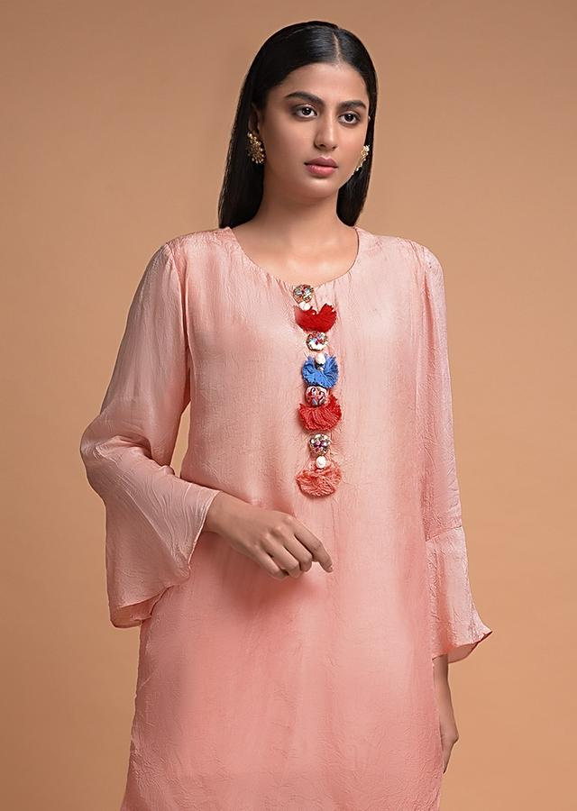 Melon Peach Sharara Suit With A Short Kurti In Crushed Crepe  Having Ruffle Sleeves Online - Kalki Fashion