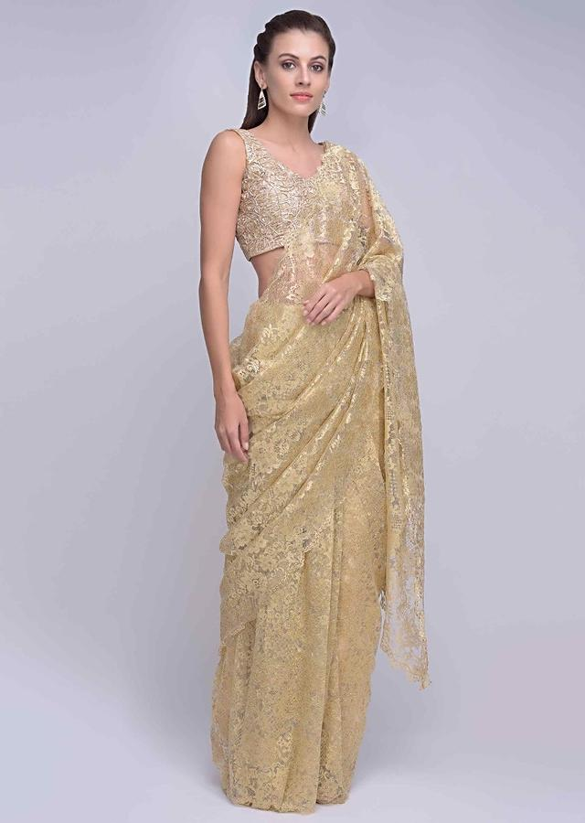 Metallic gold chantilly lace saree with scallop embroidered border only on Kalki